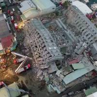 This screenshot shows an aerial view of the site of a collapsed building in the southern Taiwanese city of Tainan following a strong 6.4-magnitude earthquake that struck Taiwan early Saturday. | CTI TV / AFP-JIJI