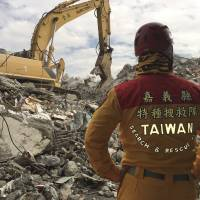 A rescue worker observes recovery work among the rubble of a collapsed building in Tainan, Taiwan, on Thursday.The final body was pulled out on Sunday. | AP