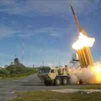 A THAAD interceptor is launched during a test at a U.S. military site on Wake Island last November.   U.S. DEPARTMENT OF DEFENSE