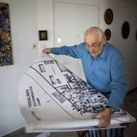 Holocaust survivor Samuel Willenberg displays a map of the Treblinka extermination camp during an interview at his house in Tel Aviv in 2010. | AP