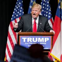 Republican presidential candidate Donald Trump speaks Sunday at a campaign event in Atlanta. Trump has repeated inaccurate and racially charged crime statistics, reposted pledges of support from white supremacists and retweeted dubious questions about the citizenship of his presidential rivals to an online following that includes more than 6 million people on Twitter alone. His response when challenged? To dismiss it all as nothing more than a harmless 'retweet.' | AP