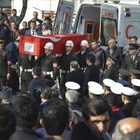 Turkish soldiers carry the national flag-draped coffin of Sgt. First Class Feyyaz Ilhan, killed in Ankara's explosion Wednesday, during his funeral in Bursa, northeastern Turkey, Thursday. Turkey blamed Kurdish militant groups at home and in neighbouring Syria on Thursday for the deadly suicide bombing in Ankara and vowed strong retaliation for the attack, a development that threatens to further complicate the Syria conflict.   DHA VIA AP
