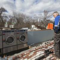Virginia Gov. Terry McAuliffe surveys tornado damage in Waverly Thursday. Residents and rescue crews on Thursday combed through wreckage left by storms that lashed the eastern United States, killing at least eight people and injuring scores across several states, officials said. | REUTERS