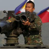 A Thai soldier prepares his equipment ahead of the opening ceremony for the Cobra Gold military exercise at the Royal Thai Marine Corps headquarters in Chonburi, Thailand, on Tuesday. | REUTERS