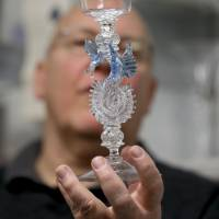 Glassblower William Gudenrath holds a dragon-stem goblet at the Corning Museum of Glass in Corning, New York. | AP