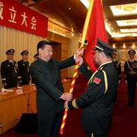 Xi tightens Communist Party's grip on military with reorganization