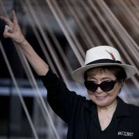 Yoko Ono poses for photographers in front of a work titled 'Morning Beams/River Bed,' at a press event to mark the opening of her exhibiition 'Land of Hope' at the Museum of Memory and Tolerance in Mexico City, Tuesday. | AP