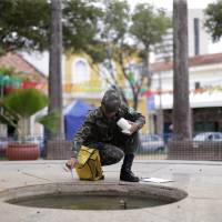 Brazilian soldiers conduct an inspection for the Aedes aegypti mosquito on a street in Recife Brazil Monday. Health authorities in the Brazilian state at the center of a rapidly spreading Zika outbreak have been overwhelmed by the alarming surge in cases of babies born with microcephaly, a neurological disorder associated to the mosquito-borne virus. | REUTERS