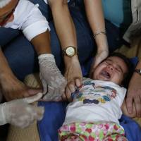 Zika a 'formidable' crisis; Bogota suspected microcephaly in discarded aborted fetus