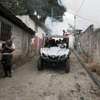 City health workers fumigate the Guadalupe community as part of preventive measures against the Zika virus and other mosquito-borne diseases in Santa Tecla, El Salvador, Wednesday. | REUTERS