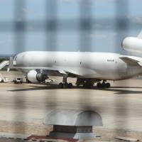 Zimbabwe impounds U.S. cargo jet after apparent dead stowaway, cash are found