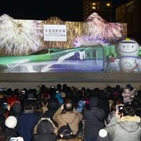 Projection-mapping of a snow sculpture of the Hokkaido Shinkansen bullet train is displayed at the Sapporo Snow Festival on Feb. 5. | KYODO