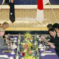 Foreign Minister Fumio Kishida and his Australian counterpart, Julie Bishop, sit down for a meeting in Tokyo on Monday.   KYODO