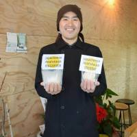 Eiji Nagao, owner of the cheese factory Japacheese, shows his products at the factory in Asahikawa, Hokkaido, in January. | KYODO