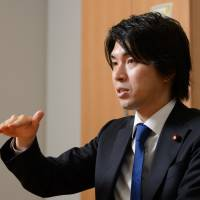Japanese lawmaker's paternity leave clashes with men-stay-at-work mindset