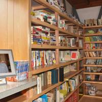 A photo of Yasuhiro Kitagawa, a reporter who died in the deadly 2011 earthquake in Christchurch, New Zealand, is placed Friday in a small library his father opened in his honor in his backyard in Hakusan, Ishikawa Prefecture. | KYODO