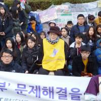 A former 'comfort woman' joins a rally outside the Japanese Embassy in Seoul on Wednesday. | KYODO