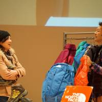 Atsushi Takehara, of outdoors gear brand The North Face, takes part in a competition for sales staff on Jan. 22 in Yokohama. His winning sales pitch included telling the customer he, too, had purchased the item and knows how to wash it. | MAGDALENA OSUMI