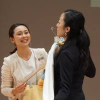 Chiaki Akada, who won the top prize in the apparel category, recommends clothing while offering tips on style during a role-playing competition for sales clerks on Jan. 22 in Yokohama. | MAGDALENA OSUMI