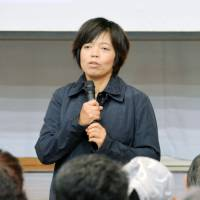 'Behind The Cove ' director Keiko Yagi addresses the residents of Taiji in Wakayama Prefecture last October at a screening of her documentary on Japan's whale and dolphin hunting. | KYODO
