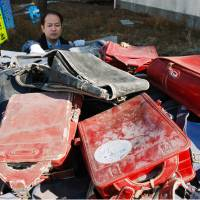 Unclaimed school backpacks pulled from 3/11 tsunami debris incinerated