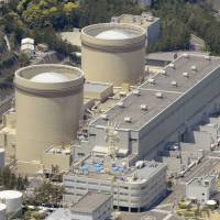 The aging No. 1 and No. 2 reactors at Kansai Electric Power Co.'s Mihama nuclear plant are seen in May 2013. | KYODO