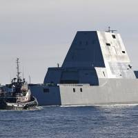 The U.S. Navy's new Zumwalt-class stealth destroyer is seen in a file photo. The Navy will renovate power distribution facilities on a pier at the Sasebo naval base in Nagasaki Prefecture to accommodate the destroyer. | AP/KYODO