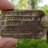 This Feb. 13 photo provided by Genevieve Cabrera shows World War II Pfc. Thomas E. Davis' Army dog tag that was found in a farm field on Saipan in early 2014. | GENEVIEVE CABRERA VIA AP