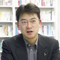 Toyo University assistant professor Daisuke Hayashi speaks during an interview last month in Tokyo's Bunkyo Ward. | KYODO