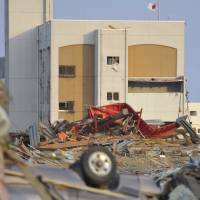 A huge tsunami caused by Great East Japan Earthquake in 2011 hit the Tohoku region, destroyed large areas near the eastern coast. The police are reviewing how evidence needs to be stored, as the tsunami washed away key items and documents at some police stations in the region. | KYODO