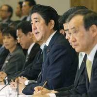 Prime Minister Shinzo Abe talks about Japan's response to North Korea's recent rocket launch during a meeting of top officials at the prime minister's office Monday. | KYODO