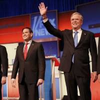 Republican U.S. presidential candidates (from left) Sen. Ted Cruz, Sen. Marco Rubio and former Gov. Jeb Bush pose before a Fox News debate in Des Moines, Iowa, on Thursday. | REUTERS