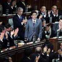 Shinzo Abe is applauded by a group of male colleagues after being elected prime minister in the Lower House in December 2012. Women are extremely underrepresented in Japan politics, where only 11.5 percent of all Diet members are female. | BLOOMBERG