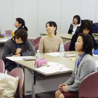 Women take in part a course designed to help them rejoin the workforce at Kwansei Gakuin University's Osaka campus last month. | KYODO