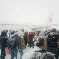 Pilot in Sapporo plane evacuation disputes police account of engine problem