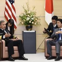 U.S. Navy Adm. Harry B. Harris Jr., commander of the United States Pacific Command, talks with Prime Minister Shinzo Abe during a meeting at the Prime Minister's Office on Tuesday. | AP