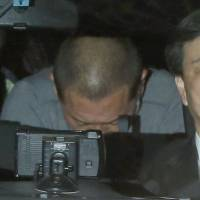 Former professional baseball star Kazuhiro Kiyohara is seen entering the Metropolitan Police Department headquarters in Tokyo at 2:15 a.m. Wednesday following his arrest late Tuesday night on suspicion of stimulant drug possession. | KYODO