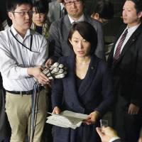 Environment Minister Tamayo Marukawa speaks at a news conference on Friday in which she retracted her remarks on the government's decontamination goal. | KYODO