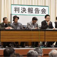 People involved in a lawsuit over the recognition of Nagasaki atomic-bomb survivors hold a news conference Monday after the Nagasaki District Court ordered authorities to recognize 10 people as A-bomb survivors based on new criteria. | KYODO