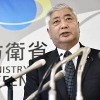 Defense Minister Gen Nakatani holds a news conference Sunday in Tokyo after North Korea's latest launch. | KYODO