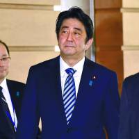 Prime Minister Shinzo Abe leaves his official residence on Sunday after a National Security Council meeting of top officials, including the defense and foreign ministers. | AFP-JIJI