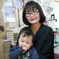 Ayane Suto, who lost her father in the 2011 quake and tsunami, speaks about her psychic experiences with her son at publisher Araemishi in Sendai on Jan. 28. | KYODO