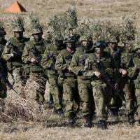 Personnel of the 1st Airborne Brigade of the Ground Self-Defense Force take part in an annual drill at the Narashino exercise field in Funabashi, Chiba Prefecture, on Jan. 10. | REUTERS