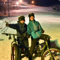 Tran Trung Kien (right), a student from Vietnam, poses for a photo with a fellow cyclist at the Togari Onsen ski resort in Iiyama, Nagano Prefecture, on Jan. 31. | KYODO