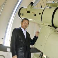 Amateur astronomer Masakatsu Aoki poses in front of his observatory in the city of Toyama on Feb. 12. | KYODO