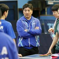 Hugo Hoyama (center) talks to members of the Brazilian national table tennis team at a training center in Sao Paulo on July 1, 2015. | KYODO