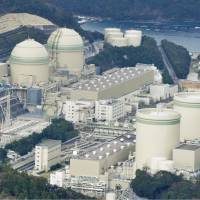 The No. 4 reactor (second from left) at the Takahama nuclear power plant in Fukui Prefecture shut down Monday. | KYODO