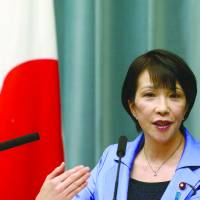 Internal Affairs and Communications Minister Sanae Takaichi speaks during a news conference at the prime minister's official residence in Tokyo in September 2014. | BLOOMBERG