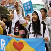 Members of the student activist group T-nsSOWL, including 16-year-old leader Aine, who only uses her first name, hold a protest rally in Shibuya Ward, Tokyo, in December. | KYODO