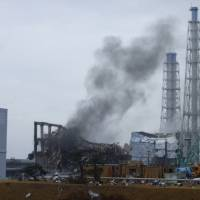 The wrecked No. 3 reactor building at the Fukushima No. 1 nuclear power plant is seen on March 21, 2011, 10 days after a quake and tsunami knocked out power to the plant. At left is reactor No. 2 and at right is reactor No. 4.  | TEPCO / AP